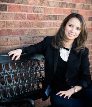 Kylynda Bauer sitting on a bench